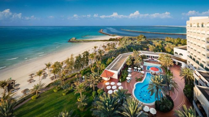 Ajman Hotel overlooks the clear blue waters of the Arabian Gulf